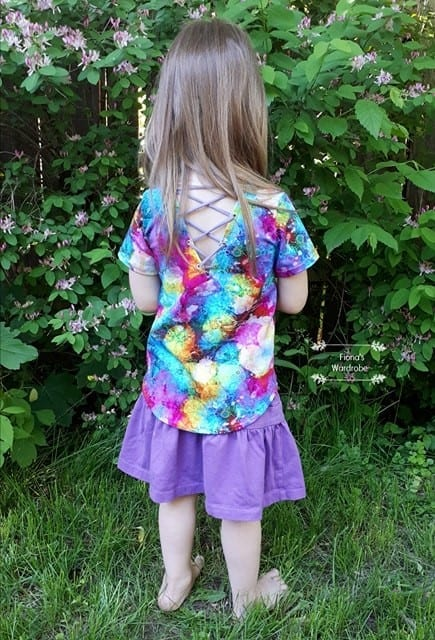 How to put a neckline facing on the Little Bow Pea instead of hemming, and cut the back piece on the fold. Plus, fun grommet/lace up back! Printable pdf sewing pattern for babies / toddlers / kids / girls.