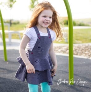Gold River Adventure Dress PDF sewing pattern for babies, toddlers, and girls. Knit and woven fabrics. Overall / dungaree dress. Easy to follow, beginner friendly instructions. #overalldresssewingpattern #sewingpattern #dungareedresssewingpattern